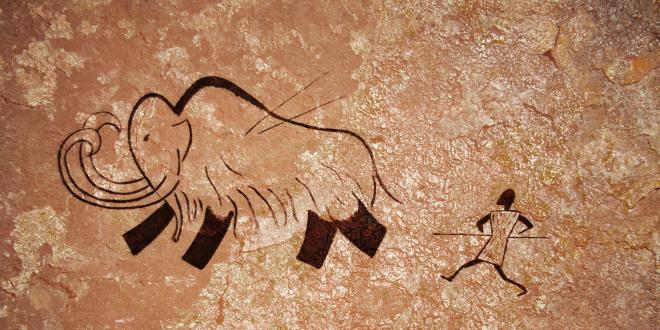 a cave drawing of hunting for food